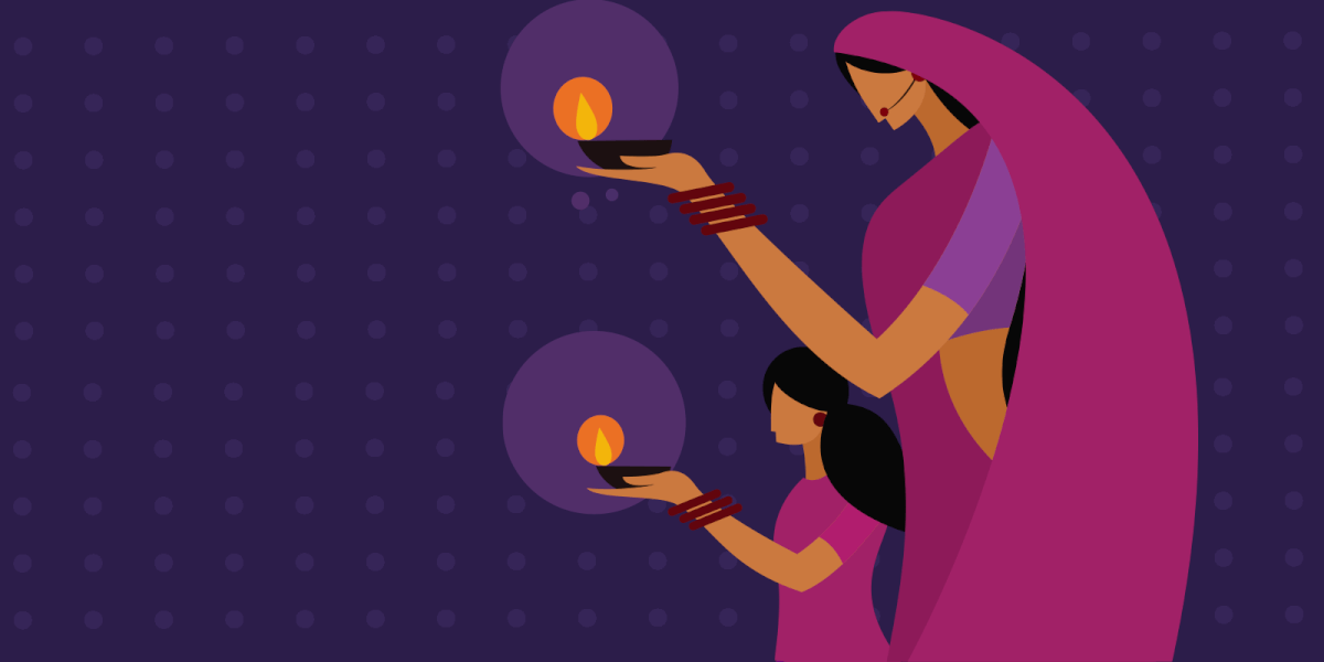 Mother and daughter carrying Diyas